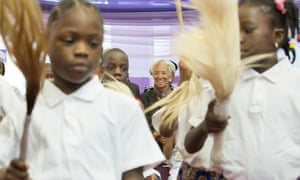 Christine Lagarde watches children perform a dance at an orphanage in Abuja during her visit to Nigeria