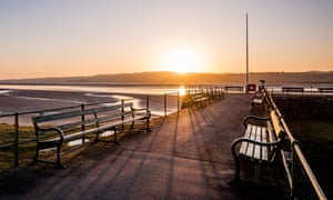 Sunset at Arnside pier: golden light on an early spring evening in Cumbria