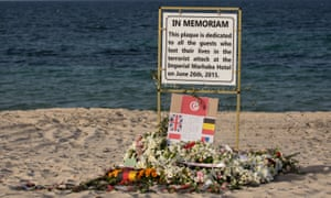 Flowers and a plaque on the beach at Sousse in Tunisia