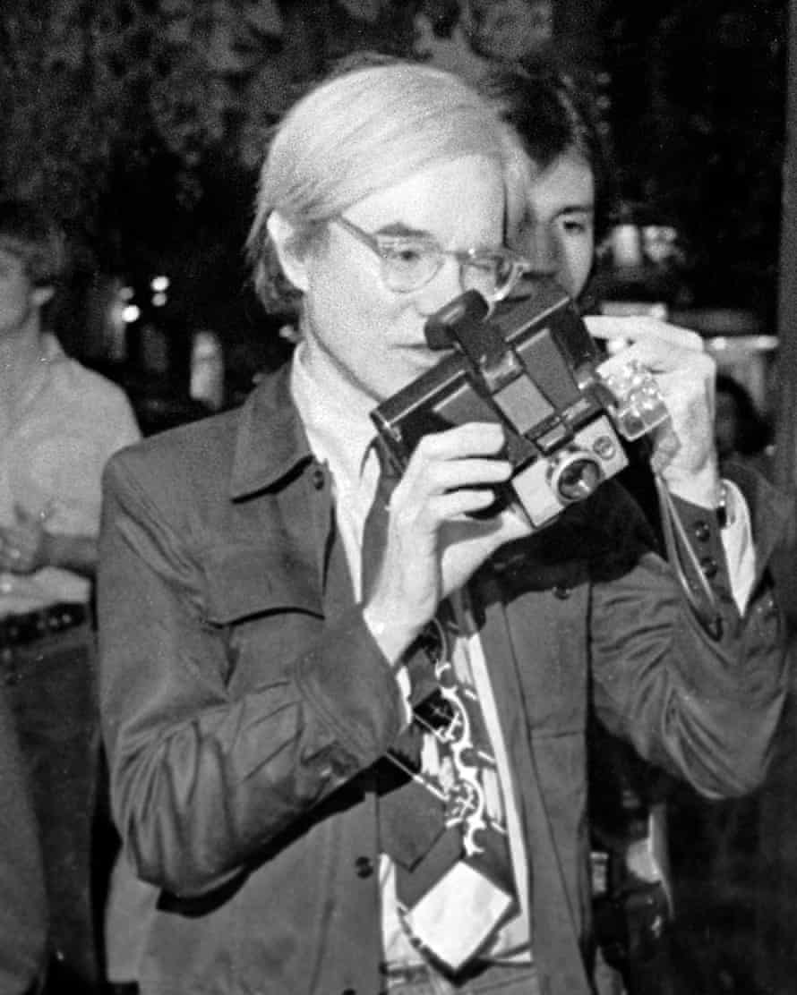 Andy Warhol with Polaroid camera in1973.