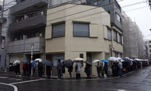 People queue around the block waiting to be seated at Tsuta.