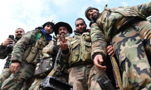 Syrian Army soldiers before advancing towards Saraqib in the country's northwestern Idlib province.