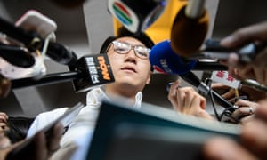 """Edward Leung speaks to the press after challenging a controversial election rules requiring candidates for upcoming elections to sign a form saying the city is an """"inalienable"""" part of China."""