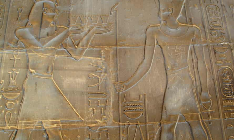 Chinese characters that read 'Ding Jinhao paid a visit here' are seen carved on a statue on the wall of an ancient temple in Luxor.