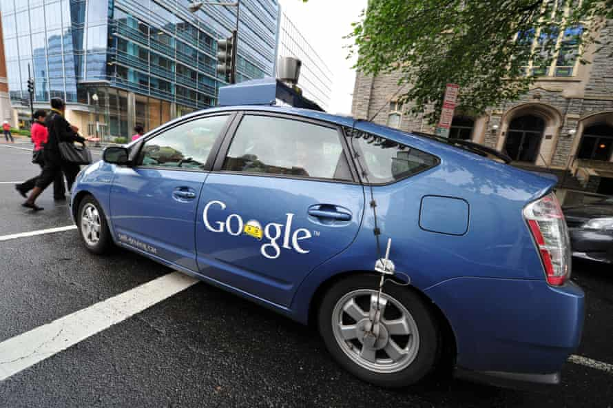 A Google self-driving prototype negotiates the streets of Washinton DC in 2012.
