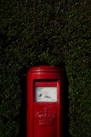 A red letterbox in Leith.