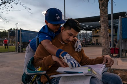Miguel studies for his mid-term exams at his younger brother's baseball game in Clovis, California.