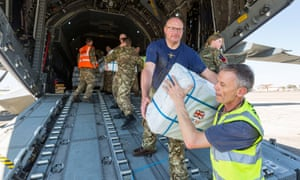 RAF personnel and charity workers offloading aid in the aftermath of cyclone Idai in Mozambique in March.