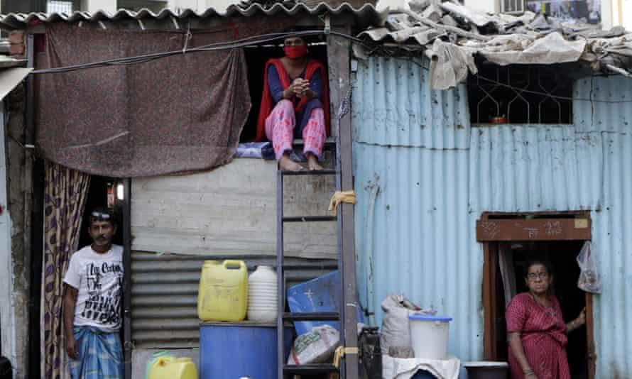 People in their shanties at Dharavi during the coronavirus lockdown in Mumbai