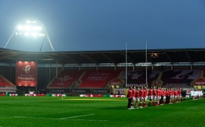 The players line up for the anthems.