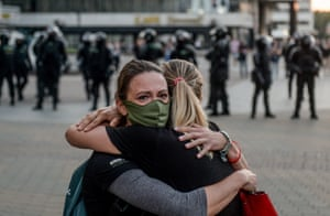 Protesters comfort each other
