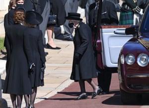 Queen exits car