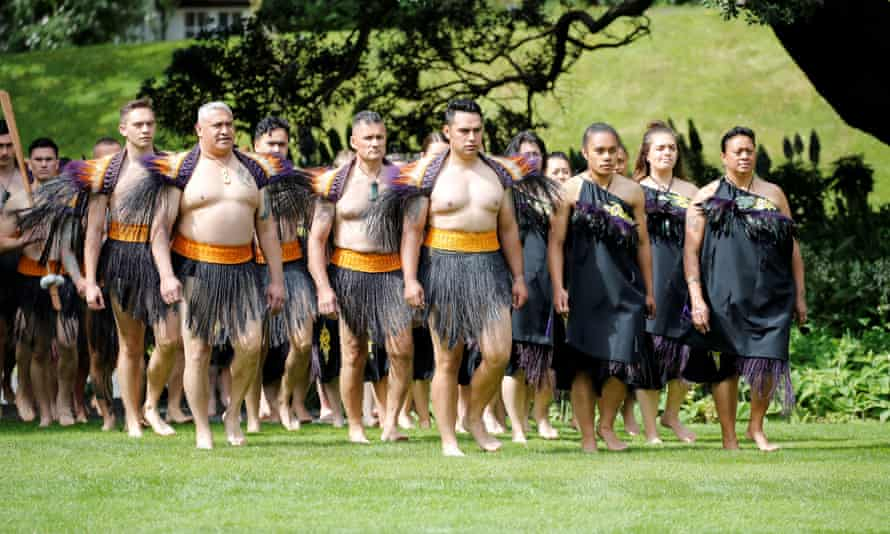 Maori warriors arrive at a ceremony in Wellington
