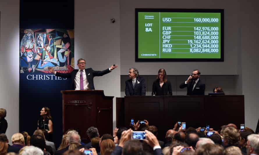 Auctioneer Jussi Pylkkanen holds his hands up after the Picasso masterpiece Les Femmes d'Alger (Version O) sold for $179.3m.