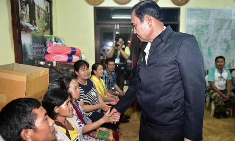 The Thai prime minister, Prayut Chan-o-cha, meets some of the trapped boys' family members