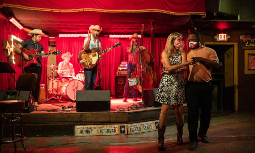 Lloyd Weatherspoon and Hope Wilson dance in masks at The White Horse on 10 March 2021 in Austin, Texas.