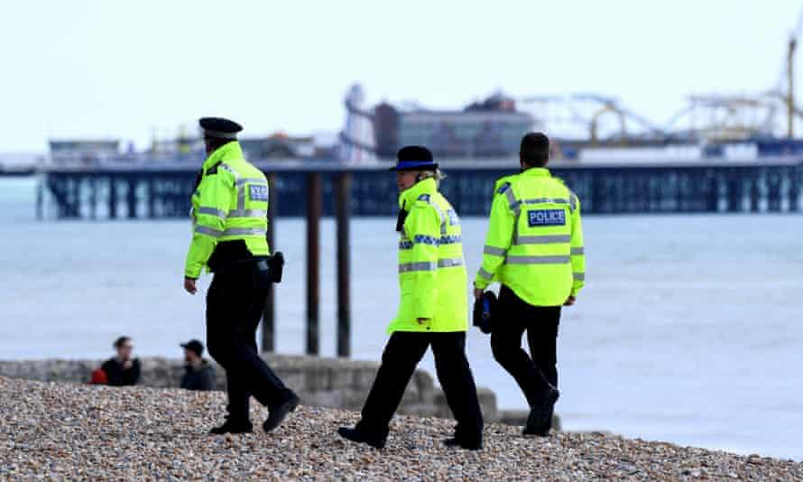 Police officers patrol Brighton beach, 31 March 2020.
