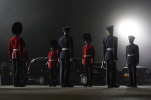 An honour guard stands at attention on a foggy tarmac before President Joe Biden and Jill Biden step off Air Force One at Cornwall airport en route to the G7 summit in Carbis Bay