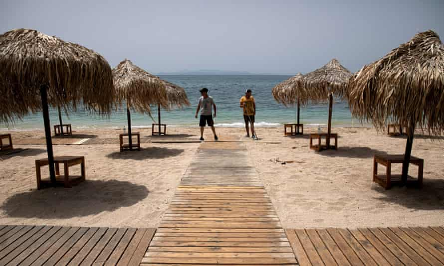 Wooden corridors installed on a beach in Athens, a day before the opening of beaches to the public following the easing of coronavirus measures.
