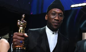 Mahershala Ali holds his best supporting actor award for his role in Green Book