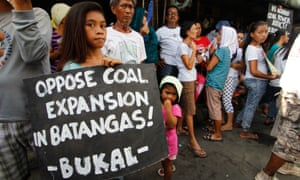 Philippines: Environmental and social groups held a protest in front of the public market and coal power plant in Calaca, Batangas on 14 May 2016, calling to stop the proposed expansion of plant.