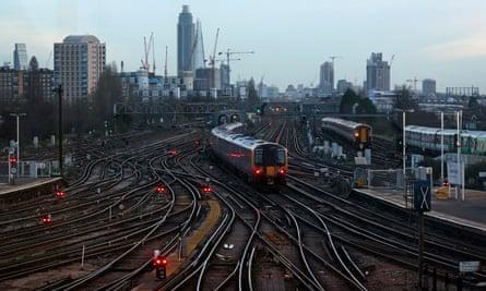 Commuter trains outside London's Clapham Junction Station.