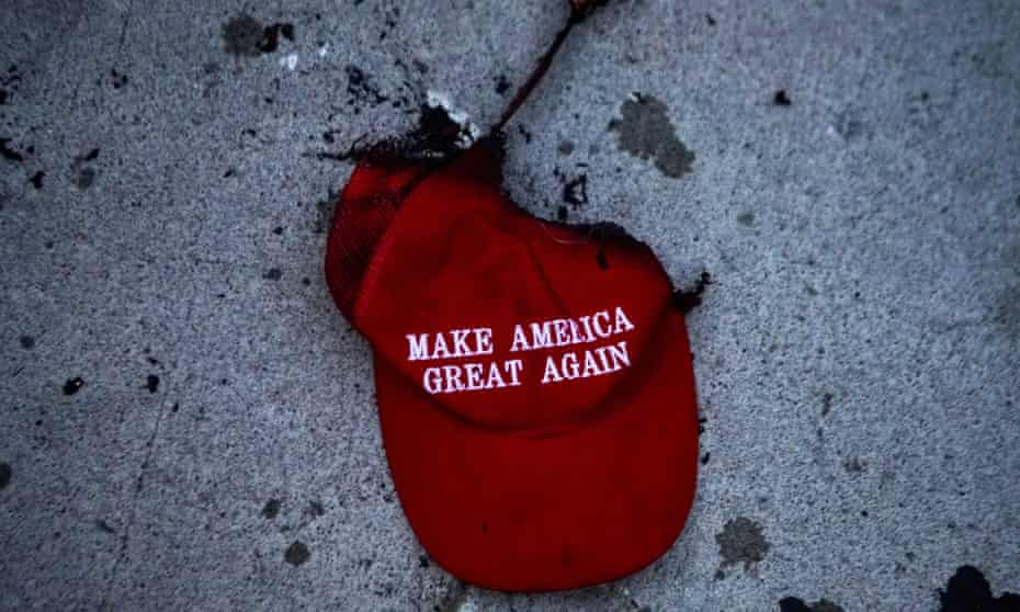 A burnt Make America Great Again (Maga) hat lies on the ground during a protest against racial injustice near the site of a rally by Donald Trump in Tulsa, Oklahoma, on 20 June 2020.