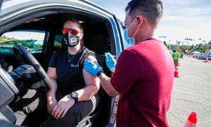 Ashley Van Dyke receives a Covid-19 shot as a mass-vaccination of healthcare workers takes place at Dodger Stadium in Los Angeles