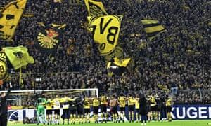 Dortmund's players celebrate after beating Bayern Munich.