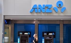 A pedestrian walks past ANZ bank