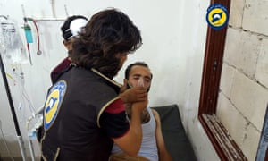 A rescue worker treats a man in Saraqeb, Idlib, said to be affected by a chlorine gas canister attack