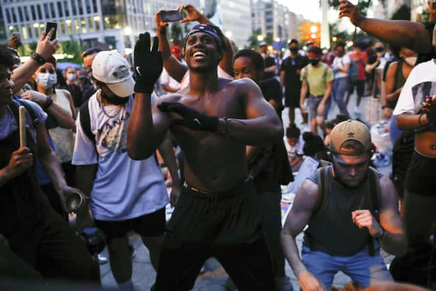 Samuel Brisbane, 19, of Baltimore, dances during a rally near the White House on Saturday.