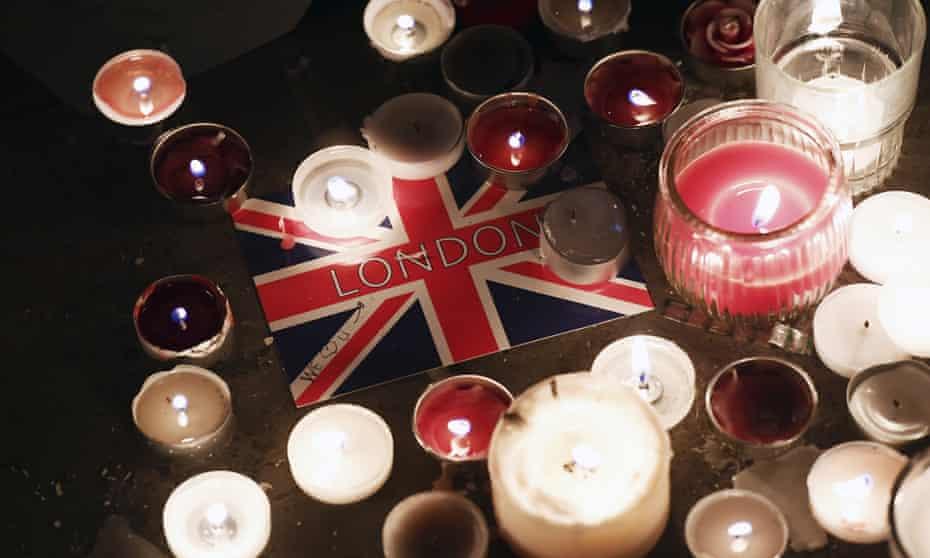 A London postcard amongst candles during a vigil in Trafalgar Square.