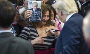 Donald Trump autographs woman's chest on the campaign trail
