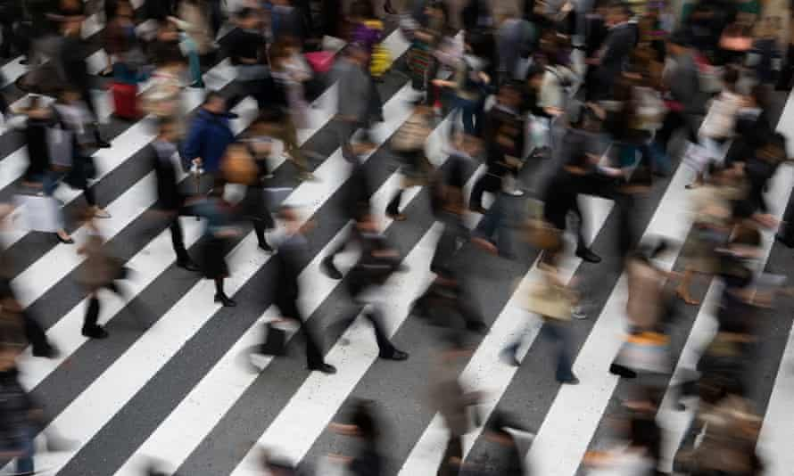 Commuters in rush hour in downtown Osaka.