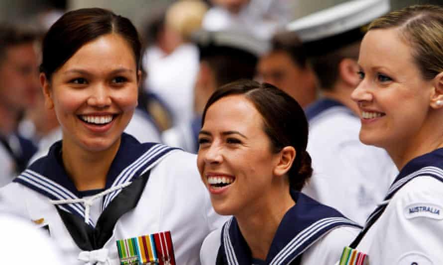 Royal Australian navy personnel share a joke.