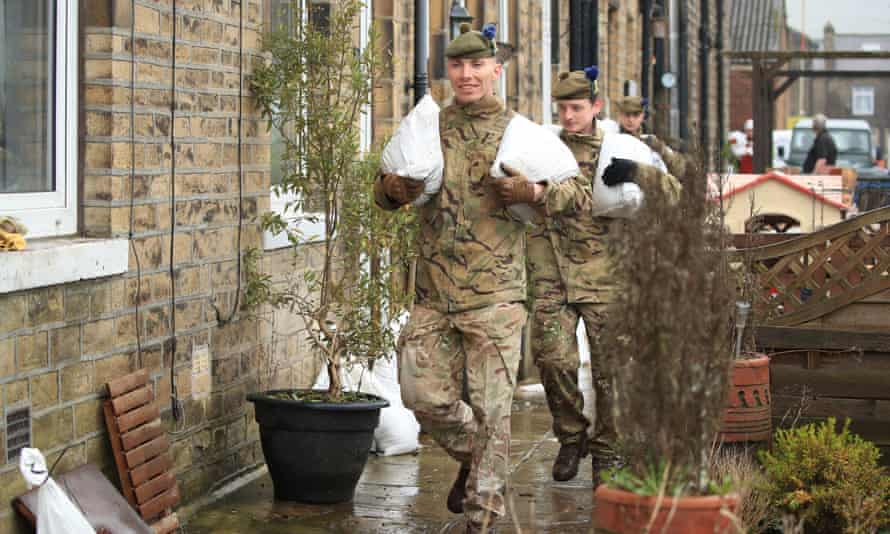 Soldiers from the Highlanders, 4th Battalion, the Royal Regiment of Scotland in Mytholmroyd assisting with flood defences, in the Upper Calder Valley in West Yorkshire.