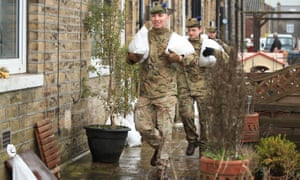 Soldiers from The Highlanders, 4th Battalion, the Royal Regiment of Scotland assisting with flood defences in Mytholmroyd
