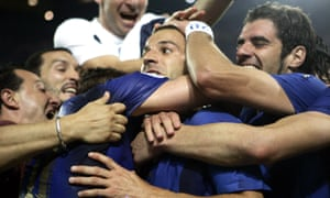 Italy's Alessandro Del Piero is mobbed by his teammates as they celebrate their second goal of the 2006 World Cup semi-final against Germany.