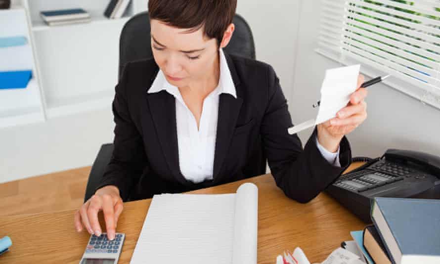 An accountant checks receipts.
