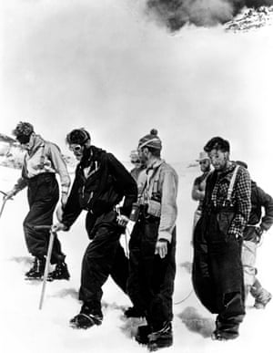 Members of the historic 1953 Everest expedition arriving back at the advanced base camp.