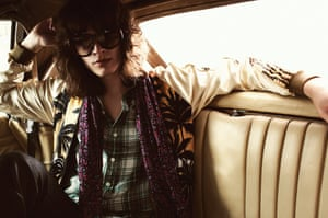 Jacket, £2,335, shirt, £385, scarf, £390, and jeans, £2,195, by Saint Laurent. Sunglasses, £355, by Linda Farrow.