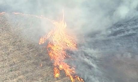 Queensland fires: 'firenado' forms as Australia blazes continue – video
