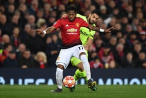 Fred of Manchester United shields the ball from Luis Suarez of Barcelona.