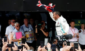 Mercedes' Lewis Hamilton celebrates after winning the race.
