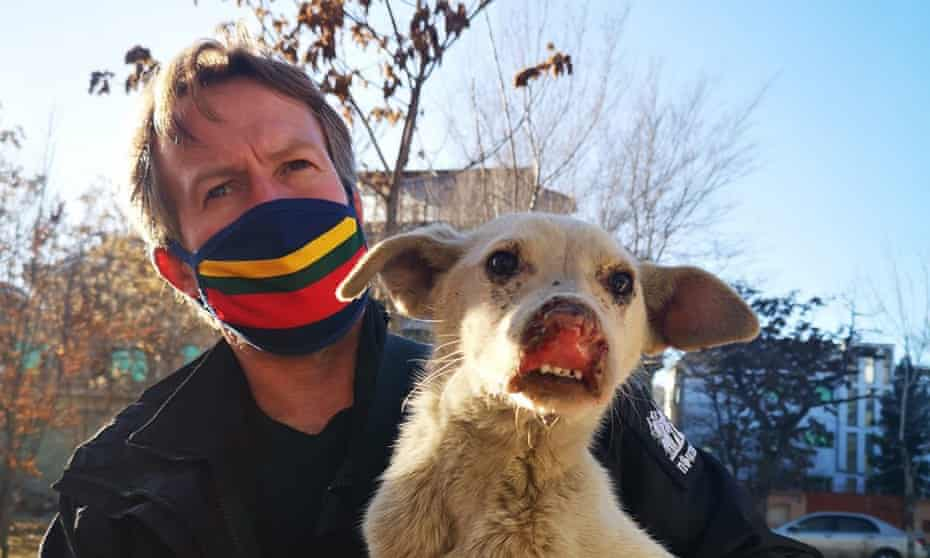 Paul 'Pen' Farthing, the founder of Nowzad animal rescue charity, with a rescued dog