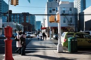 People walk through the Long Island City neighborhood on February 09, 2019 in New York City.