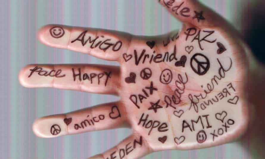 A hand with words written on it in different languages