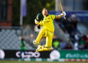 Australia's David Warner celebrates reaching his century.