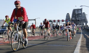 Cyclists in front of the Sydney Harbour Bridge during the annual Spring Cycle. Some fines for cyclists have risen from $71 to $425 and riders are also obliged to carry ID.